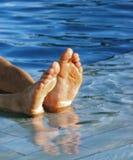 Men's feet. Happy in the pool Stock Photos
