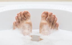 Men's feet in a bathtub, selective focus on toes Stock Photo
