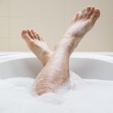 Men's feet in a bathtub, selective focus on toes Stock Image