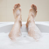 Men's feet in a bathtub, selective focus on toes Stock Photography