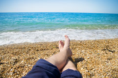 Men`s feet on the beach. On the beach Royalty Free Stock Photography