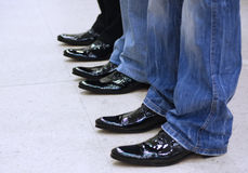 Men's feet in black leather shoes royalty free stock photo