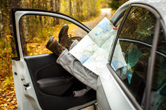 Men's feet with a map in the car. A man travels . Autumn. Men's feet with a map in the car. A man travels Stock Images