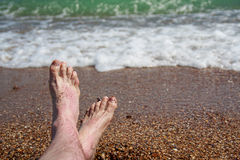 Men's feet reddened in the sun Royalty Free Stock Photography