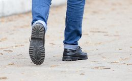 Men`s feet are on the road. In the park in nature Royalty Free Stock Photos