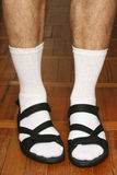 Men`s feet in sandals Stock Photo
