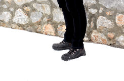 Men`s feet and shoes in snow. Winter theme Stock Images