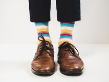 Men`s feet in stylish shoes and bright socks. Men`s style Royalty Free Stock Images