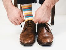 Men`s feet in stylish shoes and bright socks. Men`s style Royalty Free Stock Photography