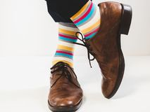 Men`s feet in stylish shoes and bright socks. Men`s style Stock Image