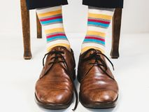 Men`s feet in stylish shoes and bright socks. Men`s style Stock Photo
