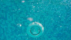Men`s feet underwater. In the pool move stock video footage
