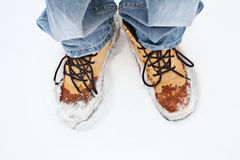 Men's feet in winter boots boot modern Stock Photography
