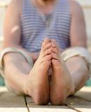Mens feet on wooden legs Royalty Free Stock Photo