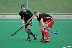 Men's field hockey action. Action during an international men's field hockey game between Germany and South Africa, Bloemfontein, South Africa, 14 March 2009 Royalty Free Stock Image