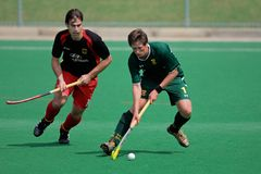 Men's field hockey action Stock Images