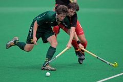 Men's field hockey action Stock Photography