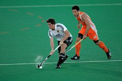 Men's field hockey action. Action during an international men's field hockey game between Germany and Netherlands, Bloemfontein, South Africa, 16 January 2010 Royalty Free Stock Image