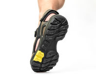 Men's foot in sandals Stock Photography
