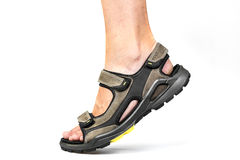 Men's foot in sandals Royalty Free Stock Image