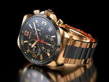 Men`s golden wristwatch on black background. Royalty Free Stock Photography