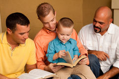 Men`s Group Bible Study. Father reading the bible with his son. Father reading the bible with his son. Men`s Group Bible Study royalty free stock image