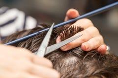 Men`s hair cutting scissors. In a beauty salon stock photography