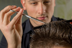 Men's hair cutting with scissors in a beauty salon stock images