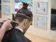 Men`s hair makes in the Barber shop. stock images