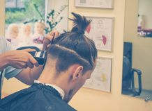 Men`s hair makes in the barber shop. stock photography