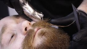 Men`s hairstyling and haircutting in a barber shop or hair salon. stock footage