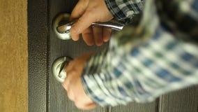 Men`s hand closes the door. Close up stock video footage