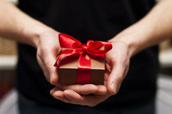 Men's hand holding gift box Stock Photography