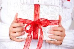 Men's hand holding gift box Stock Images