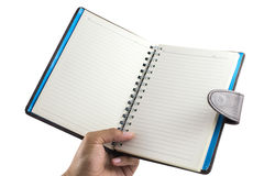 Men's hand holding Notebook isolate on a white background with blank screen and can be add your texts or others on Notebook.N. Otebook concept Stock Photo