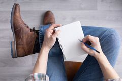 Free Men`s Hand Holding Pencil And Notebook. Student Male Hand Writing Or Drawing Stock Images - 218947294