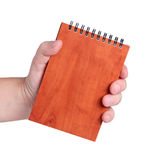 Men's hand holds a notebook. Stock Photography