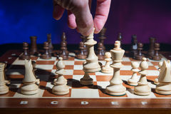 Men's hand move the chess Stock Photos