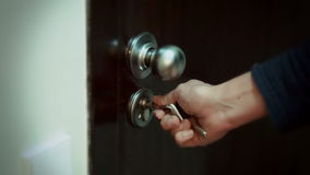 Men`s hand opens the door. Men`s hand opening door with a key stock footage