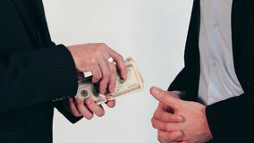 Men`s hand passes money. Monetary deal on white background. You did a great job. Financial fredoom means a lot stock video