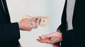 Men`s hand passes money. Monetary deal on white background. You did a great job. Financial fredoom means a lot stock footage