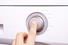 Men`s hand presses a finger on the control button.2. Men`s hand presses a finger on the control button Stock Images