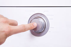 Men`s hand presses a finger on the control button.1. Men`s hand presses a finger on the control button Royalty Free Stock Photos