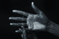 Men's hand in a silver paint Royalty Free Stock Image