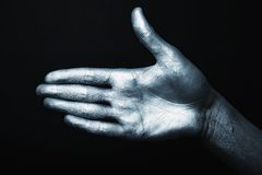 Men's hand in a silver paint isolated Stock Photo