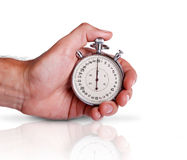 Mens hand with stopwatch on the surface Royalty Free Stock Image