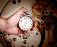 Mens hand with timer and watch mechanism Royalty Free Stock Photos