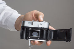 Men's hand with vintage camera Royalty Free Stock Images