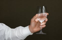 Men's hand with a wineglass of water Stock Photography