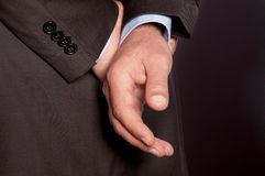 Men's hands behind his back closeup Royalty Free Stock Photo